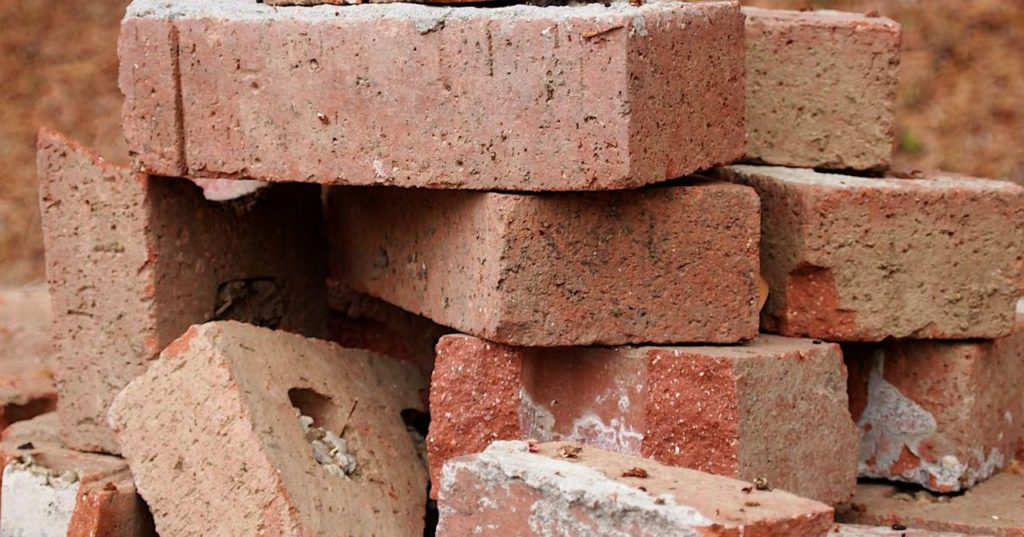 A Rwandan Engineer Is Recycling Glass Bottles Into Bricks